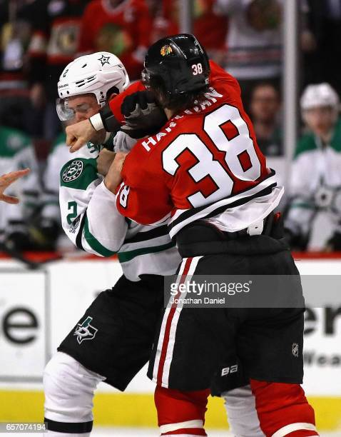 Ryan Hartman of the Chicago Blackhawks and Dan Hamhuis of the Dallas Stars fight in the second period at the United Center on March 23 2017 in...