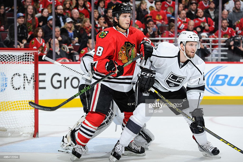 <a gi-track='captionPersonalityLinkClicked' href=/galleries/search?phrase=Ryan+Hartman&family=editorial&specificpeople=9156569 ng-click='$event.stopPropagation()'>Ryan Hartman</a> #38 of the Chicago Blackhawks and <a gi-track='captionPersonalityLinkClicked' href=/galleries/search?phrase=Derek+Forbort&family=editorial&specificpeople=7069666 ng-click='$event.stopPropagation()'>Derek Forbort</a> #7 of the Los Angeles Kings watch for the puck in the second period of the NHL game at the United Center on November 2, 2015 in Chicago, Illinois.