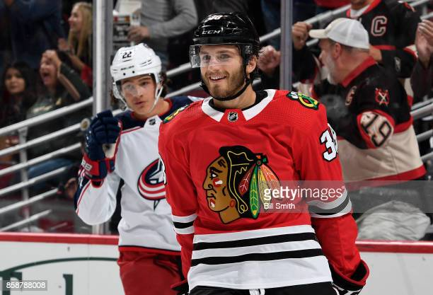 Ryan Hartman of the Chicago Blackhawks reacts in front of Sonny Milano of the Columbus Blue Jackets after the Blackhawks scored in the first period...
