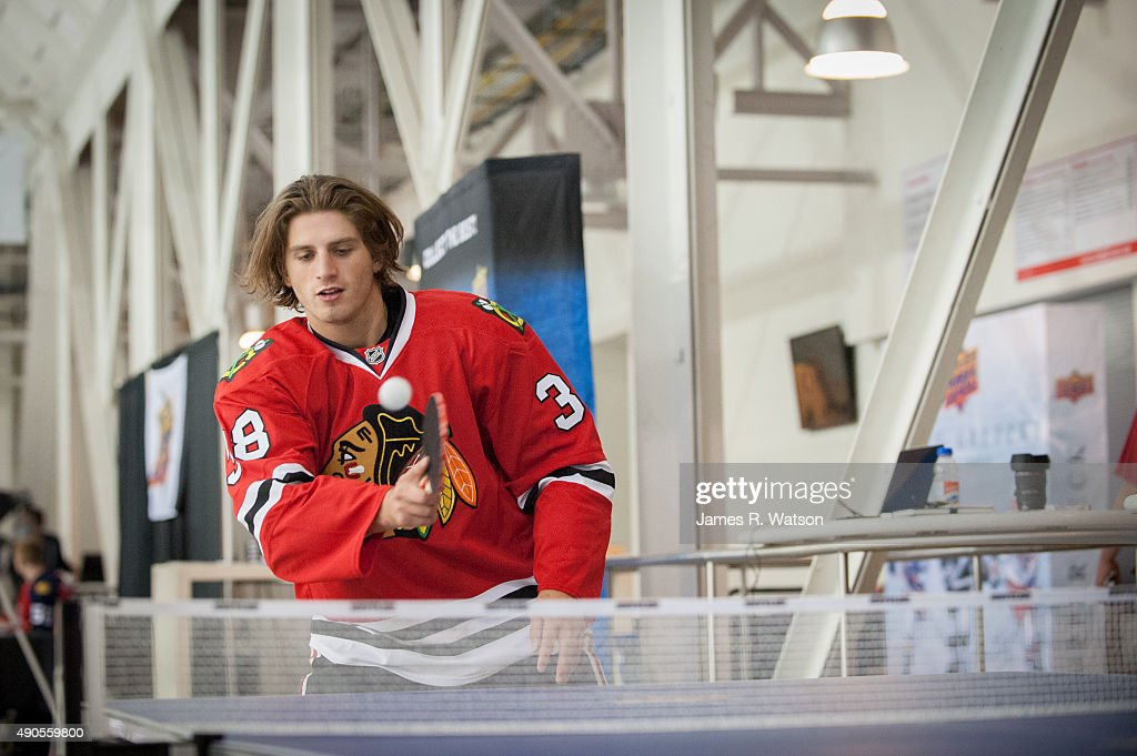 Ryan Hartman #38 of the Chicago Blackhawks warms up with a game of ping-pong during the 2015 NHLPA Rookie Showcase at Mattamy Athletic Centre on September 1, 2015 in Toronto , Ontario , Canada .