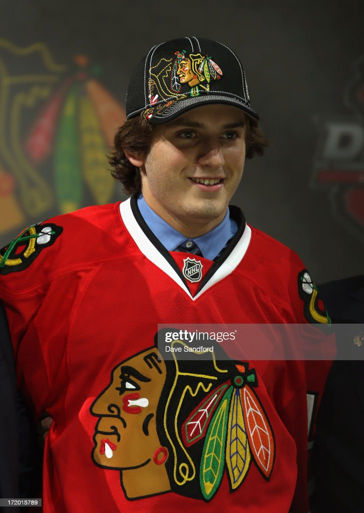 <a gi-track='captionPersonalityLinkClicked' href=/galleries/search?phrase=Ryan+Hartman&family=editorial&specificpeople=9156569 ng-click='$event.stopPropagation()'>Ryan Hartman</a> smiles after being selected 30th overall by the Chicago Blackhawks during the 2013 NHL Draft at Prudential Center on June 30, 2013 in Newark, New Jersey.