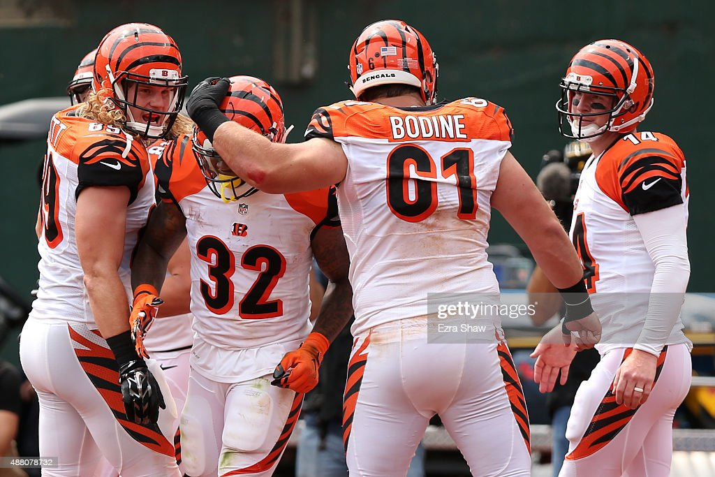 Ryan Hewitt #89, Jeremy Hill #32, Russell Bodine #61 and Andy Dalton #14 celebrate a touchdown by Hill during the first half of their NFL game against the Oakland Raiders at O.co Coliseum on September 13, 2015 in Oakland, California.