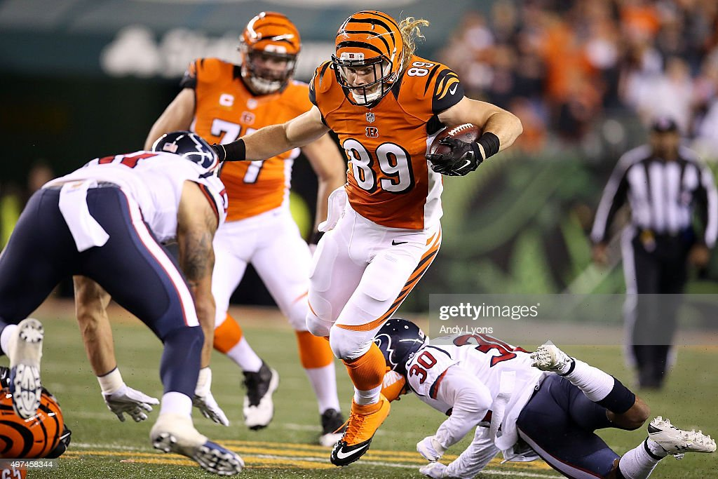 Ryan Hewitt #89 of the Cincinnati Bengals is tripped up by Kevin Johnson #30 of the Houston Texans during the second quarter at Paul Brown Stadium on November 16, 2015 in Cincinnati, Ohio.