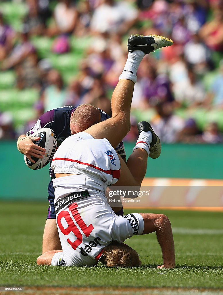 Ryan Hinchcliffe of the Storm collides with Matt Prior of the Dragons during the round one NRL match between the Melbourne Storm and the St George Illawarra Dragons at AAMI Park on March 10, 2013 in Melbourne, Australia.