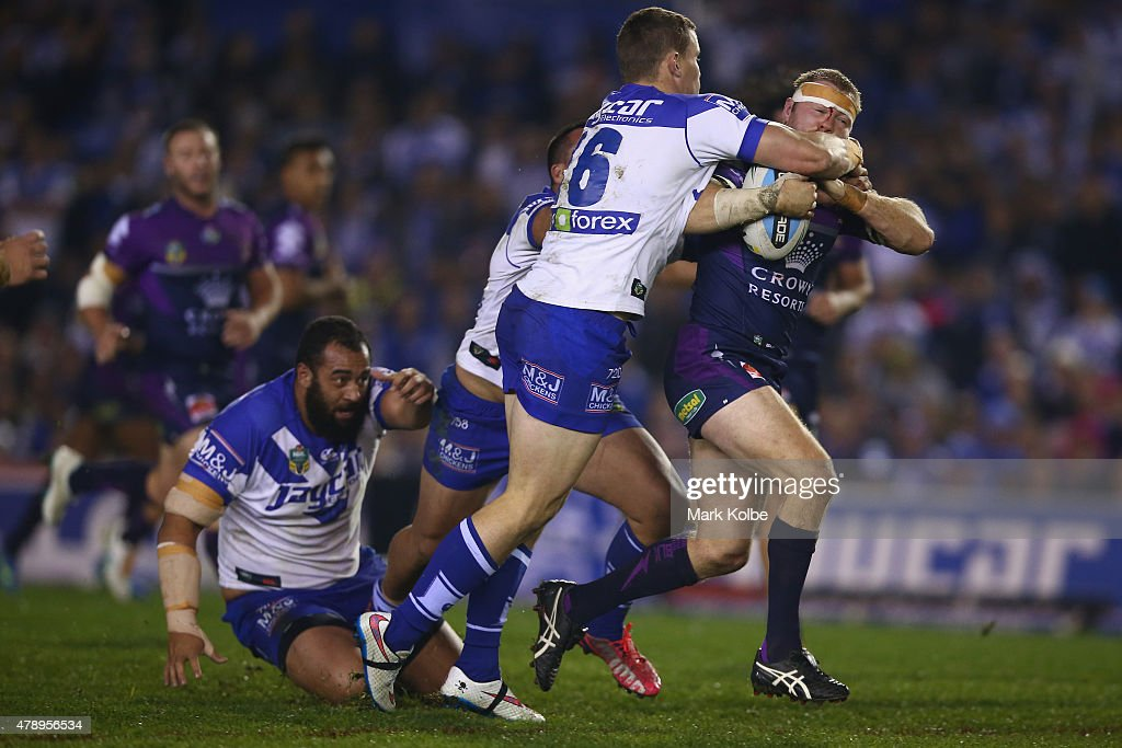 Ryan Hinchcliffe of the Storm is tackled during the round 16 NRL match between the Canterbury Bulldogs and the Melbourne Storm at Belmore Sports Ground on June 29, 2015 in Sydney, Australia.