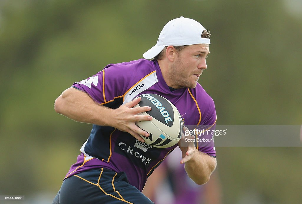 Ryan Hinchcliffe of the Storm runs with the ball during a Melbourne Storm NRL training session at Gosch's Paddock on January 25, 2013 in Melbourne, Australia.