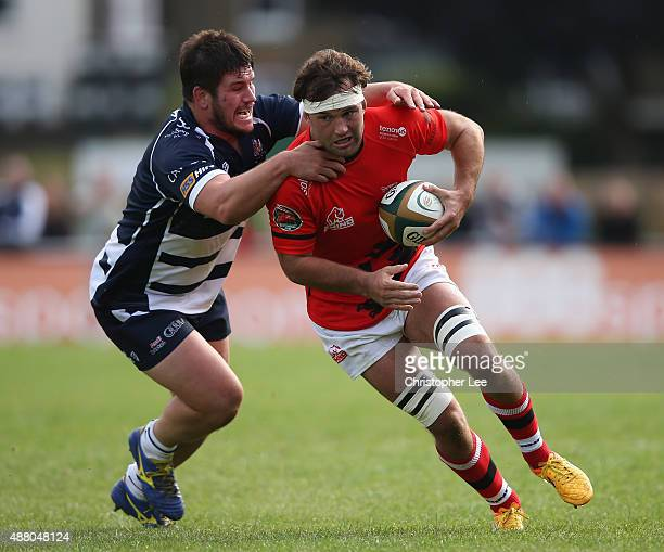 Ryan Hodson of Welsh is tackled by Marc Jones of Bristol during the Greene King IPA Championship match between London Welsh and Bristol at Old Deer...