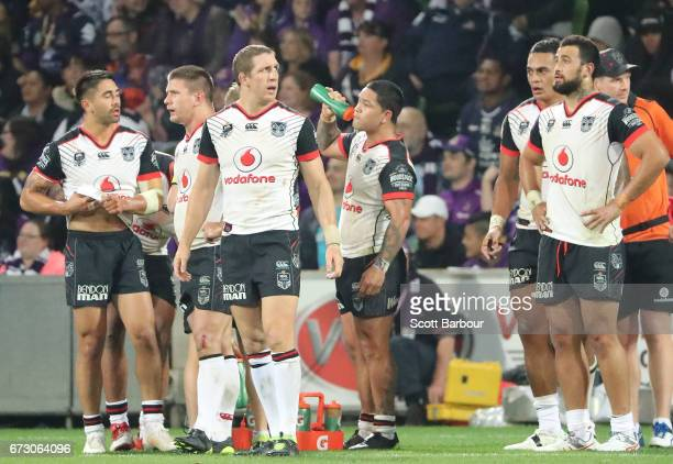 Ryan Hoffman and the Warriors stand behind their line after conceeding a try during the round eight NRL match between the Melbourne Storm and the New...