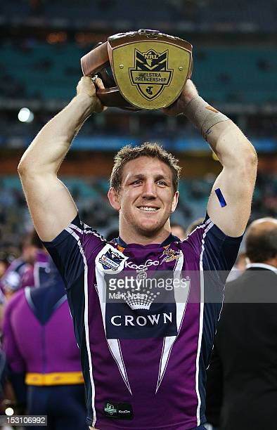 Ryan Hoffman holds the NRL premiership trophy after the 2012 NRL Grand Final match between the Melbourne Storm and the Canterbury Bulldogs at ANZ...