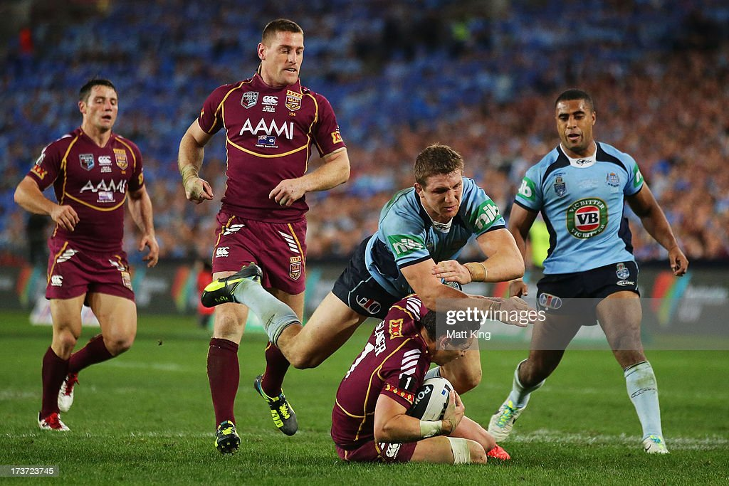 Ryan Hoffman of the Blues tackles Billy Slater of the Maroons during game three of the ARL State of Origin series between the New South Wales Blues and the Queensland Maroons at ANZ Stadium on July 17, 2013 in Sydney, Australia.