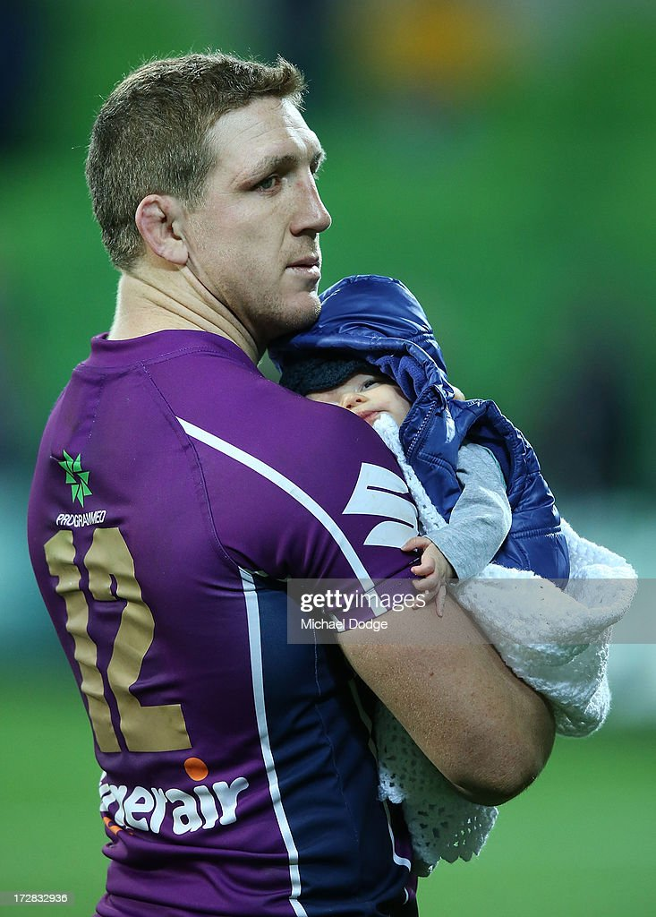 <a gi-track='captionPersonalityLinkClicked' href=/galleries/search?phrase=Ryan+Hoffman&family=editorial&specificpeople=204420 ng-click='$event.stopPropagation()'>Ryan Hoffman</a> of the Storm celebrates the win with his baby son Zach Hoffman during the round 17 NRL match between the Melbourne Storm and the Brisbane Broncos at AAMI Park on July 5, 2013 in Melbourne, Australia.