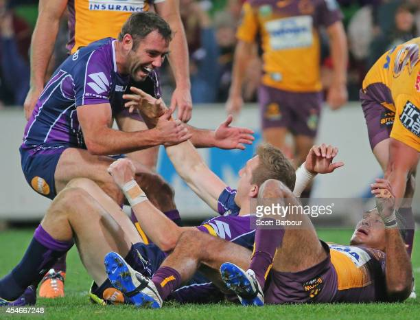 Ryan Hoffman of the Storm is congratulated by Cameron Smith after scoring a try during the round 26 NRL match between the Melbourne Storm and the...