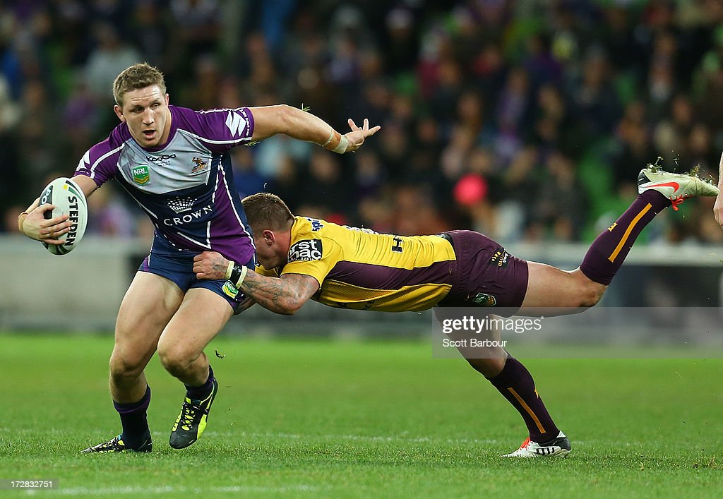 <a gi-track='captionPersonalityLinkClicked' href=/galleries/search?phrase=Ryan+Hoffman&family=editorial&specificpeople=204420 ng-click='$event.stopPropagation()'>Ryan Hoffman</a> of the Storm is tackled by Josh McGuire of the Broncos during the round 17 NRL match between the Melbourne Storm and the Brisbane Broncos at AAMI Park on July 5, 2013 in Melbourne, Australia.