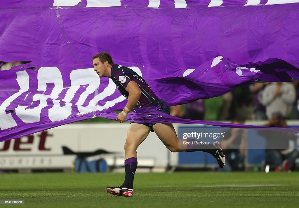 Ryan Hoffman of the Storm runs through the team banner as he takes the field to play his 200th NRL match during the round three NRL match between the Melbourne Storm and the Canterbury Bulldogs at AAMI Park on March 21, 2013 in Melbourne, Australia.