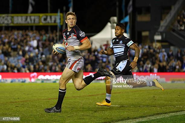 Ryan Hoffman of the Warriors charges down a kick and makes a break during the round nine NRL match between the Sharks and the Warriors at Remondis...
