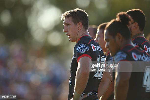 Ryan Hoffman of the Warriors looks dejected after a Tigers try during the round one NRL match between the Wests Tigers and the New Zealand Warriors...
