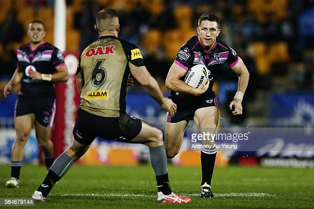 Ryan Hoffman of the Warriors on the charge against Bryce Cartwright of the Panthers during the round 21 NRL match between the New Zealand Warriors...