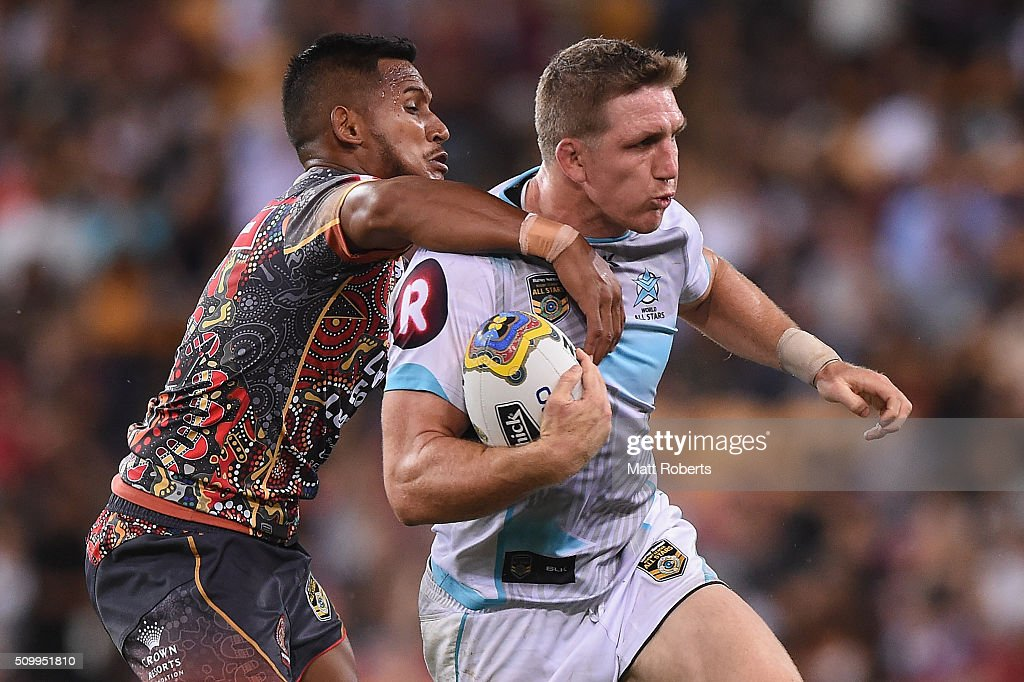 Ryan Hoffman of the World All Stars is tackled by Ben Barba of the Indigenous All Stars during the NRL match between the Indigenous All-Stars and the World All-Stars at Suncorp Stadium on February 13, 2016 in Brisbane, Australia.