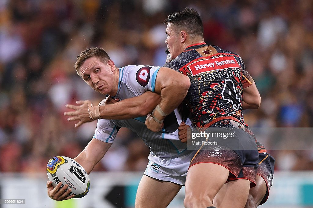 Ryan Hoffman of the World All Stars looks to offload in the tackle of Ben Barba and James Roberts of the Indigenous All Stars during the NRL match between the Indigenous All-Stars and the World All-Stars at Suncorp Stadium on February 13, 2016 in Brisbane, Australia.