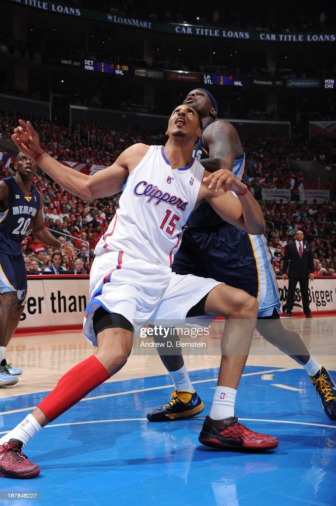 Ryan Hollins #15 of the Los Angeles Clippers battles for a rebound against Zach Randolph #50 of the Memphis Grizzlies at Staples Center in Game Five of the Western Conference Quarterfinals during the 2013 NBA Playoffs on April 30, 2013 in Los Angeles, California.