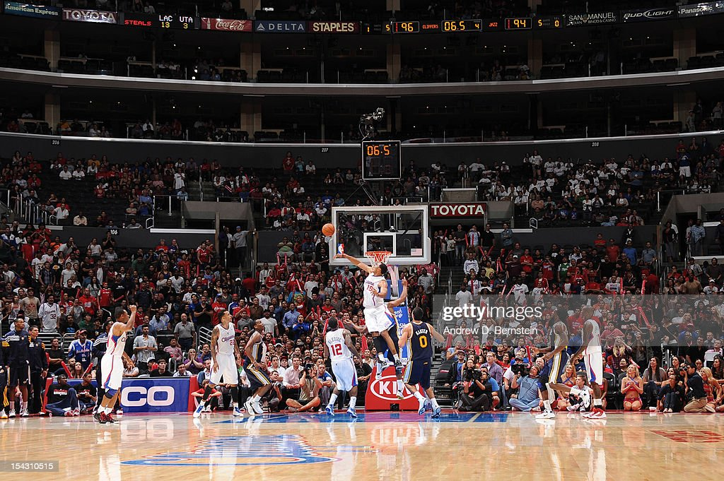 <a gi-track='captionPersonalityLinkClicked' href=/galleries/search?phrase=Ryan+Hollins&family=editorial&specificpeople=182556 ng-click='$event.stopPropagation()'>Ryan Hollins</a> #15 of the Los Angeles Clippers blocks a shot attempt by <a gi-track='captionPersonalityLinkClicked' href=/galleries/search?phrase=Randy+Foye&family=editorial&specificpeople=240185 ng-click='$event.stopPropagation()'>Randy Foye</a> #8 of the Utah Jazz with seconds left in the fourth quarter during a pre-season game at Staples Center on October 17, 2012 in Los Angeles, California.