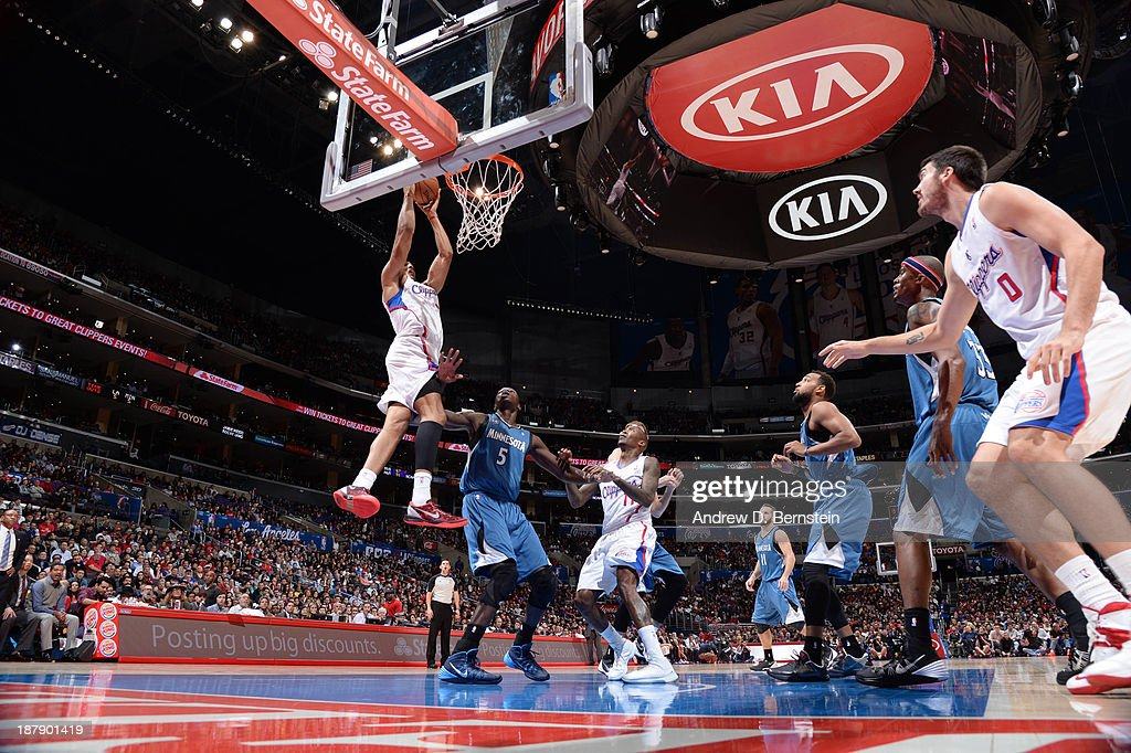 <a gi-track='captionPersonalityLinkClicked' href=/galleries/search?phrase=Ryan+Hollins&family=editorial&specificpeople=182556 ng-click='$event.stopPropagation()'>Ryan Hollins</a> #15 of the Los Angeles Clippers dunks over <a gi-track='captionPersonalityLinkClicked' href=/galleries/search?phrase=Gorgui+Dieng&family=editorial&specificpeople=7363274 ng-click='$event.stopPropagation()'>Gorgui Dieng</a> #5 of the Minnesota Timberwolves at Staples Center on November 11, 2013 in Los Angeles, California.