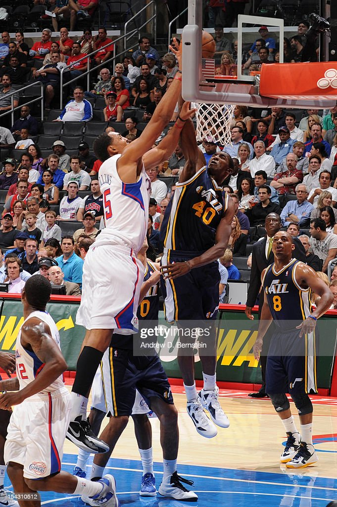 <a gi-track='captionPersonalityLinkClicked' href=/galleries/search?phrase=Ryan+Hollins&family=editorial&specificpeople=182556 ng-click='$event.stopPropagation()'>Ryan Hollins</a> #15 of the Los Angeles Clippers goes to the basket against Jeremy Evans #40 of the Utah Jazz during a pre-season game at Staples Center on October 17, 2012 in Los Angeles, California.
