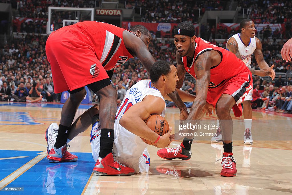 <a gi-track='captionPersonalityLinkClicked' href=/galleries/search?phrase=Ryan+Hollins&family=editorial&specificpeople=182556 ng-click='$event.stopPropagation()'>Ryan Hollins</a> #15 of the Los Angeles Clippers grabs a loose ball against the Portland Trail Blazers at Staples Center on April 16, 2013 in Los Angeles, California.