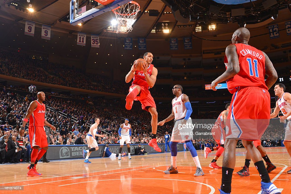 Ryan Hollins #15 of the Los Angeles Clippers grabs a rebound against Amar'e Stoudemire #1 of the New York Knicks during the game at Madison Square Garden on February 10, 2013 in New York City.