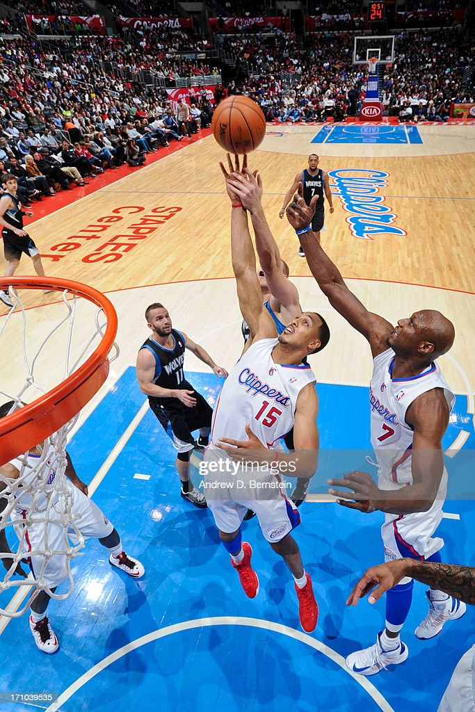 <a gi-track='captionPersonalityLinkClicked' href=/galleries/search?phrase=Ryan+Hollins&family=editorial&specificpeople=182556 ng-click='$event.stopPropagation()'>Ryan Hollins</a> #15 of the Los Angeles Clippers reaches for a rebound against the Minnesota Timberwolves at Staples Center on April 10, 2013 in Los Angeles, California.