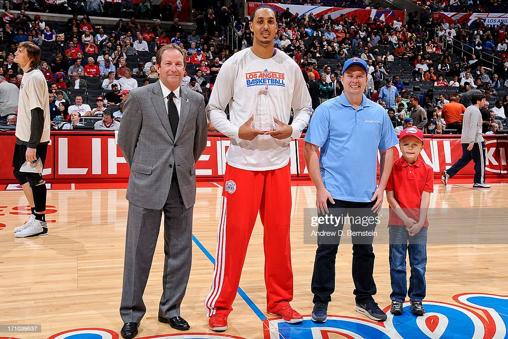 <a gi-track='captionPersonalityLinkClicked' href=/galleries/search?phrase=Ryan+Hollins&family=editorial&specificpeople=182556 ng-click='$event.stopPropagation()'>Ryan Hollins</a> #15 of the Los Angeles Clippers receives the Kia Community Service Award before playing the Minnesota Timberwolves at Staples Center on April 10, 2013 in Los Angeles, California.
