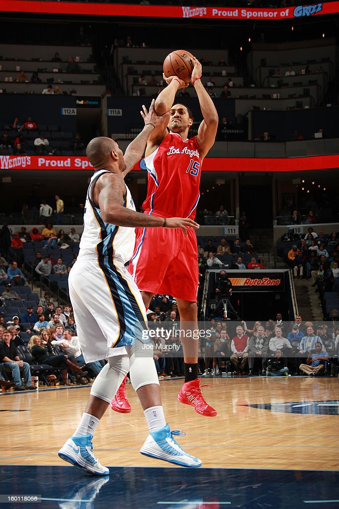 Ryan Hollins #15 of the Los Angeles Clippers shoots against Marreese Speights #5 of the Memphis Grizzlies on January 14, 2013 at FedExForum in Memphis, Tennessee.