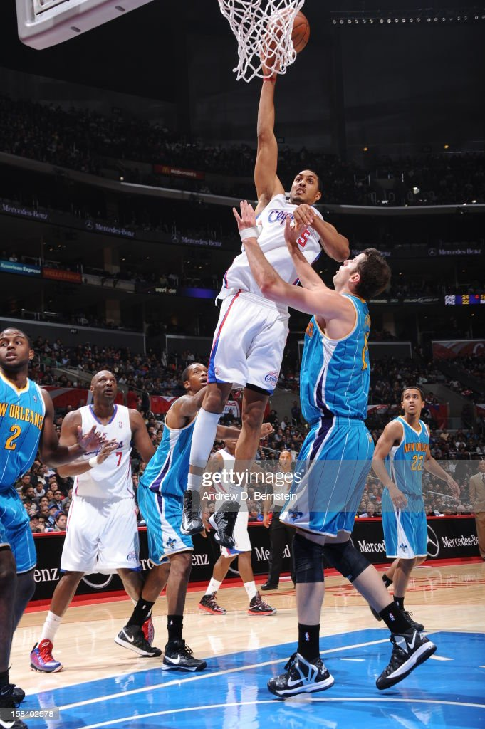 Ryan Hollins #15 of the Los Angeles Clippers shoots the ball against Jason Smith #14 of the New Orleans Hornets at Staples Center on November 26, 2012 in Los Angeles, California.