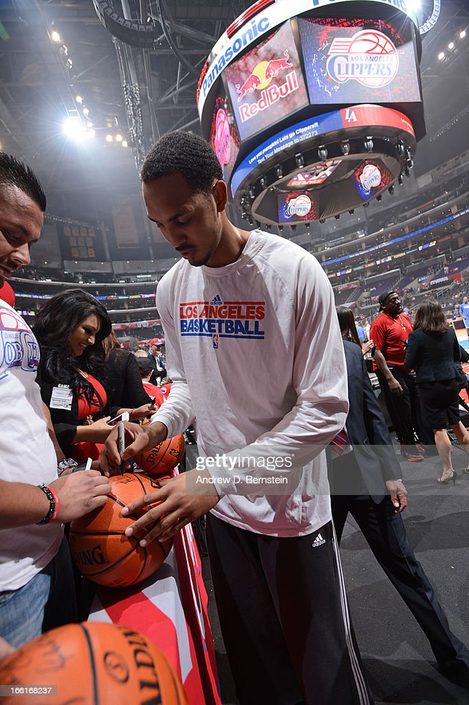 <a gi-track='captionPersonalityLinkClicked' href=/galleries/search?phrase=Ryan+Hollins&family=editorial&specificpeople=182556 ng-click='$event.stopPropagation()'>Ryan Hollins</a> #15 of the Los Angeles Clippers signs autographs before the game against the Oklahoma City Thunder at Staples Center on March 3, 2013 in Los Angeles, California.