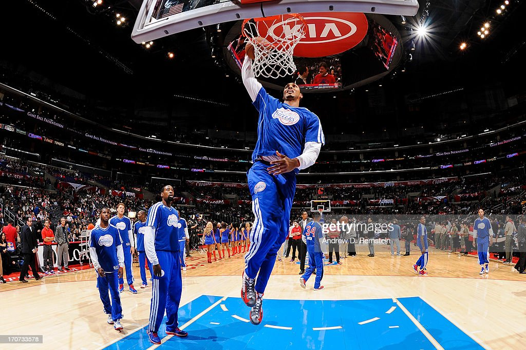 <a gi-track='captionPersonalityLinkClicked' href=/galleries/search?phrase=Ryan+Hollins&family=editorial&specificpeople=182556 ng-click='$event.stopPropagation()'>Ryan Hollins</a> #15 of the Los Angeles Clippers warms up before playing against the Sacramento Kings at Staples Center on December 21, 2012 in Los Angeles, California.
