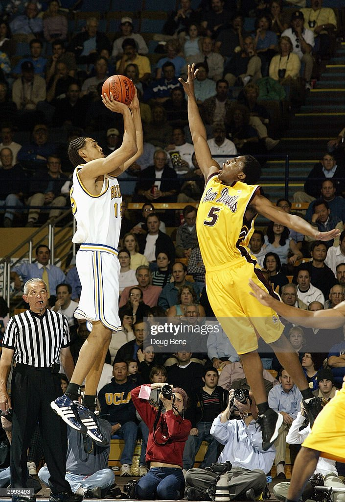 Ryan Hollins of the UCLA Bruins shoots over Ike Diogu of the Arizona State Sun Devils during the game on January 15 2004 at Pauley Pavillion in...