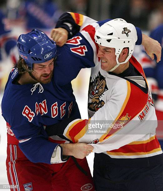 Ryan Hollweg of the New York Rangers takes a punch from Steve Montador of the Florida Panthers during their second period fight on December 10 2006...
