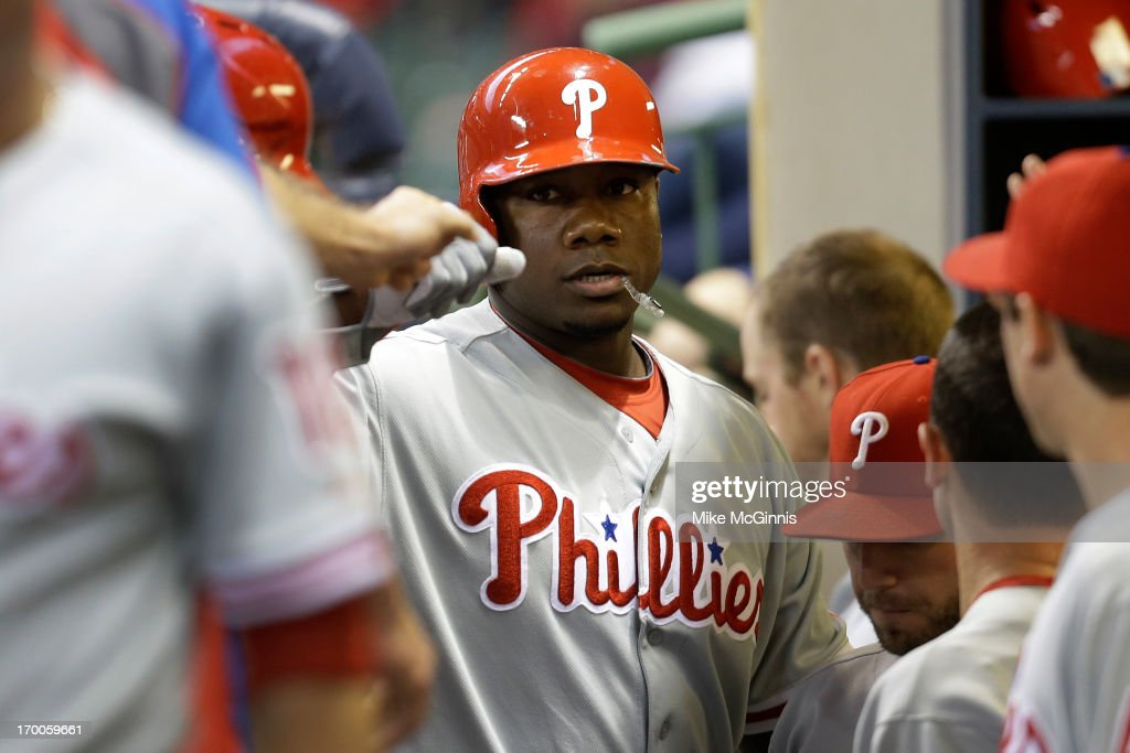 <a gi-track='captionPersonalityLinkClicked' href=/galleries/search?phrase=Ryan+Howard&family=editorial&specificpeople=551402 ng-click='$event.stopPropagation()'>Ryan Howard</a> #8 of the Philadelphia is congratulated in the dugout during action against the Milwaukee Brewers at Miller Park on June 06, 2013 in Milwaukee, Wisconsin.