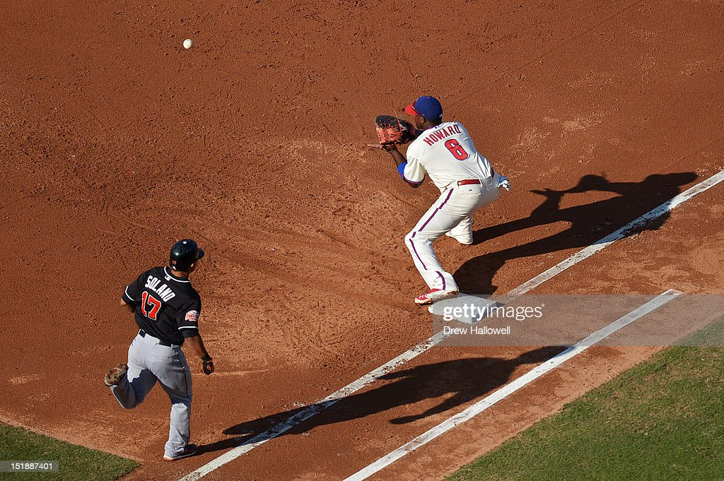 <a gi-track='captionPersonalityLinkClicked' href=/galleries/search?phrase=Ryan+Howard&family=editorial&specificpeople=551402 ng-click='$event.stopPropagation()'>Ryan Howard</a> #6 of the Philadelphia Phillies catches the ball to put out Donovan Solano #17 of the Miami Marlins at Citizens Bank Park on September 12, 2012 in Philadelphia, Pennsylvania.