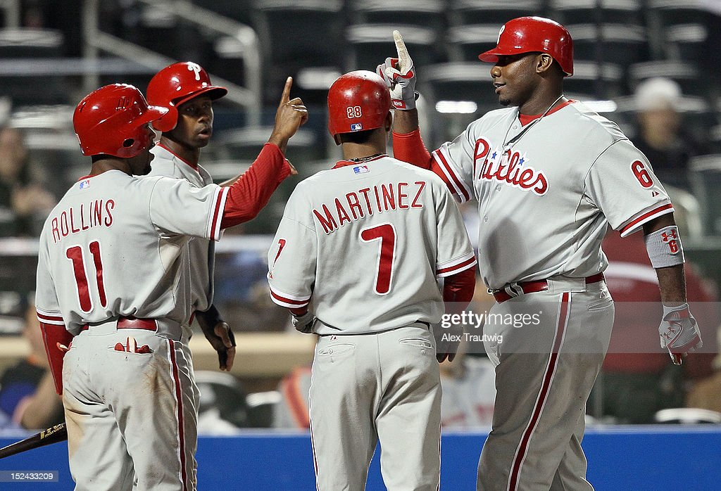 <a gi-track='captionPersonalityLinkClicked' href=/galleries/search?phrase=Ryan+Howard&family=editorial&specificpeople=551402 ng-click='$event.stopPropagation()'>Ryan Howard</a> #6 of the Philadelphia Phillies celebrates a grand slam against the New York Mets with <a gi-track='captionPersonalityLinkClicked' href=/galleries/search?phrase=Jimmy+Rollins&family=editorial&specificpeople=204478 ng-click='$event.stopPropagation()'>Jimmy Rollins</a> #11, <a gi-track='captionPersonalityLinkClicked' href=/galleries/search?phrase=Juan+Pierre&family=editorial&specificpeople=202961 ng-click='$event.stopPropagation()'>Juan Pierre</a> #10, and Michael Martinez #7 at Citi Field on September 20, 2012 in the Flushing neighborhood of the Queens borough of New York City.