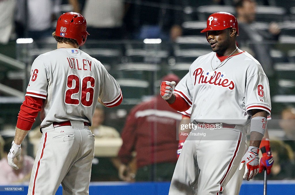 <a gi-track='captionPersonalityLinkClicked' href=/galleries/search?phrase=Ryan+Howard&family=editorial&specificpeople=551402 ng-click='$event.stopPropagation()'>Ryan Howard</a> #6 of the Philadelphia Phillies celebrates a two run home run in the ninth inning with teammate <a gi-track='captionPersonalityLinkClicked' href=/galleries/search?phrase=Chase+Utley&family=editorial&specificpeople=161391 ng-click='$event.stopPropagation()'>Chase Utley</a> against the New York Mets at Citi Field on September 19, 2012 in the Flushing neighborhood of the Queens borough of New York City.