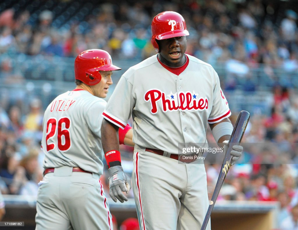 <a gi-track='captionPersonalityLinkClicked' href=/galleries/search?phrase=Ryan+Howard&family=editorial&specificpeople=551402 ng-click='$event.stopPropagation()'>Ryan Howard</a> #6 of the Philadelphia Phillies celebrates after <a gi-track='captionPersonalityLinkClicked' href=/galleries/search?phrase=Chase+Utley&family=editorial&specificpeople=161391 ng-click='$event.stopPropagation()'>Chase Utley</a> #26 scores during the first inning of a baseball game against the San Diego Padres at Petco Park on June 26, 2013 in San Diego, California.