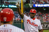 Ryan Howard of the Philadelphia Phillies celebrates after hitting a solo home run in the second inning during a game against the New York Mets at...