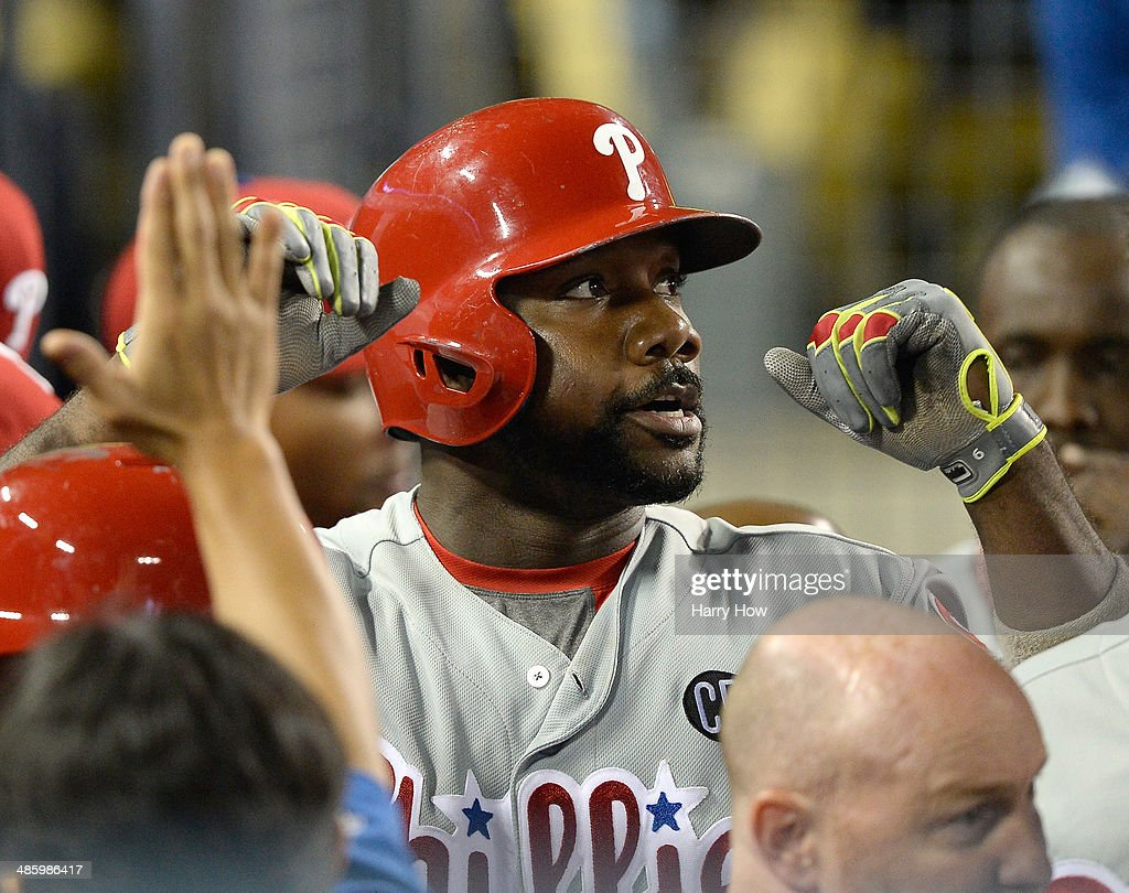 <a gi-track='captionPersonalityLinkClicked' href=/galleries/search?phrase=Ryan+Howard&family=editorial&specificpeople=551402 ng-click='$event.stopPropagation()'>Ryan Howard</a> #6 of the Philadelphia Phillies celebrates his two run homerun for a 4-0 lead over the Los Angeles Dodgers in the dugout during the fifth inning at Dodger Stadium on April 21, 2014 in Los Angeles, California.