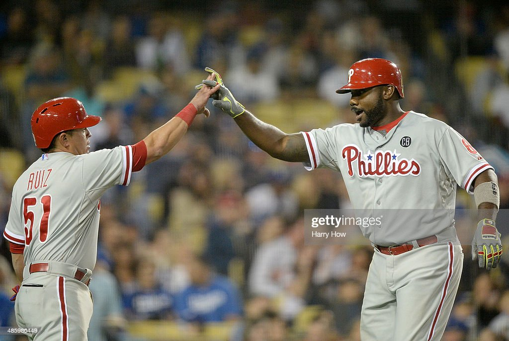 <a gi-track='captionPersonalityLinkClicked' href=/galleries/search?phrase=Ryan+Howard&family=editorial&specificpeople=551402 ng-click='$event.stopPropagation()'>Ryan Howard</a> #6 of the Philadelphia Phillies celebrates his two run homerun with Carlos Ruiz #51 for a 4-0 lead over the Los Angeles Dodgers during the fifth inning at Dodger Stadium on April 21, 2014 in Los Angeles, California.