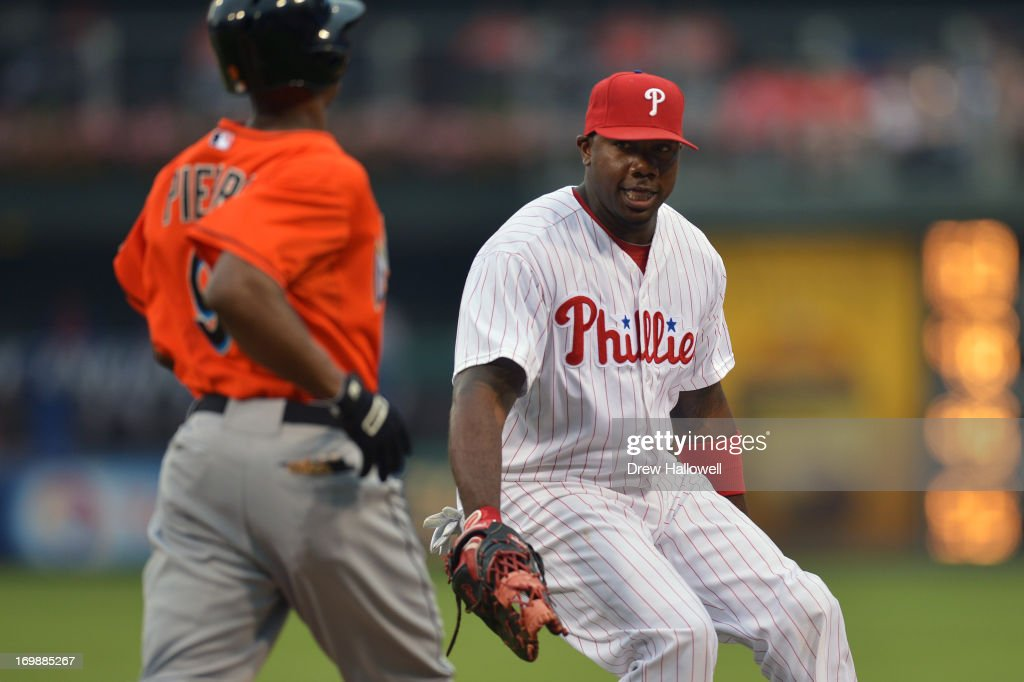 <a gi-track='captionPersonalityLinkClicked' href=/galleries/search?phrase=Ryan+Howard&family=editorial&specificpeople=551402 ng-click='$event.stopPropagation()'>Ryan Howard</a> #6 of the Philadelphia Phillies charges at <a gi-track='captionPersonalityLinkClicked' href=/galleries/search?phrase=Juan+Pierre&family=editorial&specificpeople=202961 ng-click='$event.stopPropagation()'>Juan Pierre</a> #9 of the Miami Marlins to tag him out in the first inning at Citizens Bank Park on June 3, 2013 in Philadelphia, Pennsylvania.