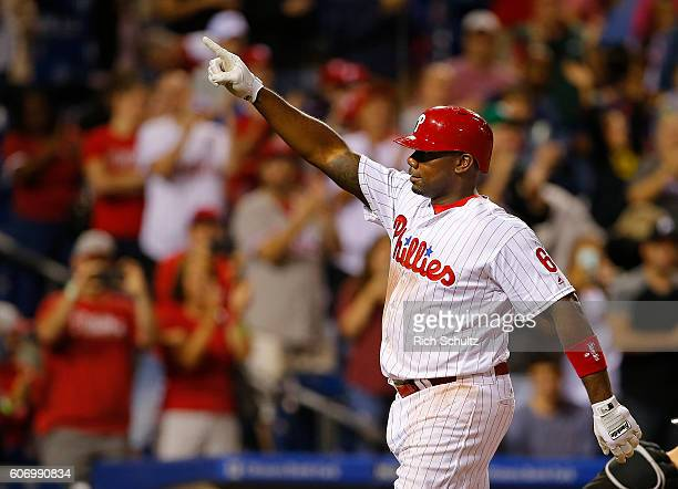 Ryan Howard of the Philadelphia Phillies gestures after hitting a home run against the Miami Marlins during the sixth inning of a game at Citizens...