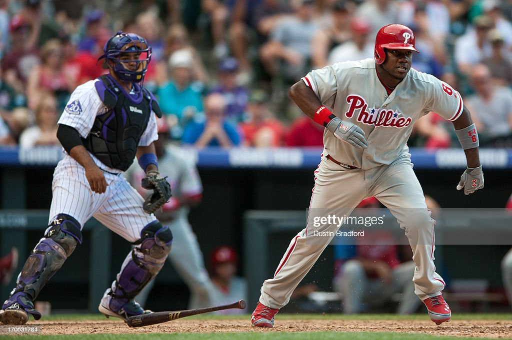 <a gi-track='captionPersonalityLinkClicked' href=/galleries/search?phrase=Ryan+Howard&family=editorial&specificpeople=551402 ng-click='$event.stopPropagation()'>Ryan Howard</a> #6 of the Philadelphia Phillies hits an RBI double in the top of eighth inning of a game against the Colorado Rockies at Coors Field on June 15, 2013 in Denver, Colorado. The Rockies beat the Phillies 10-5.