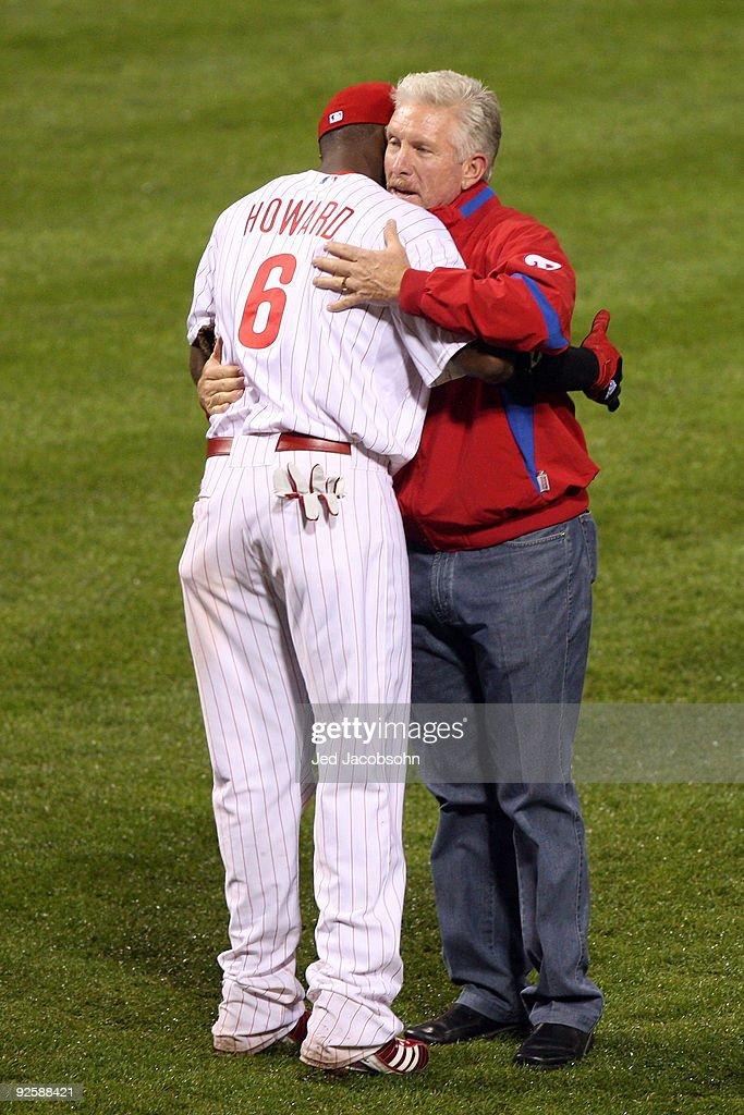 Ryan Howard #6 of the Philadelphia Phillies hug former Phillies Mike Schmidt before Game Three of the 2009 MLB World Series at Citizens Bank Park on October 31, 2009 in Philadelphia, Pennsylvania.