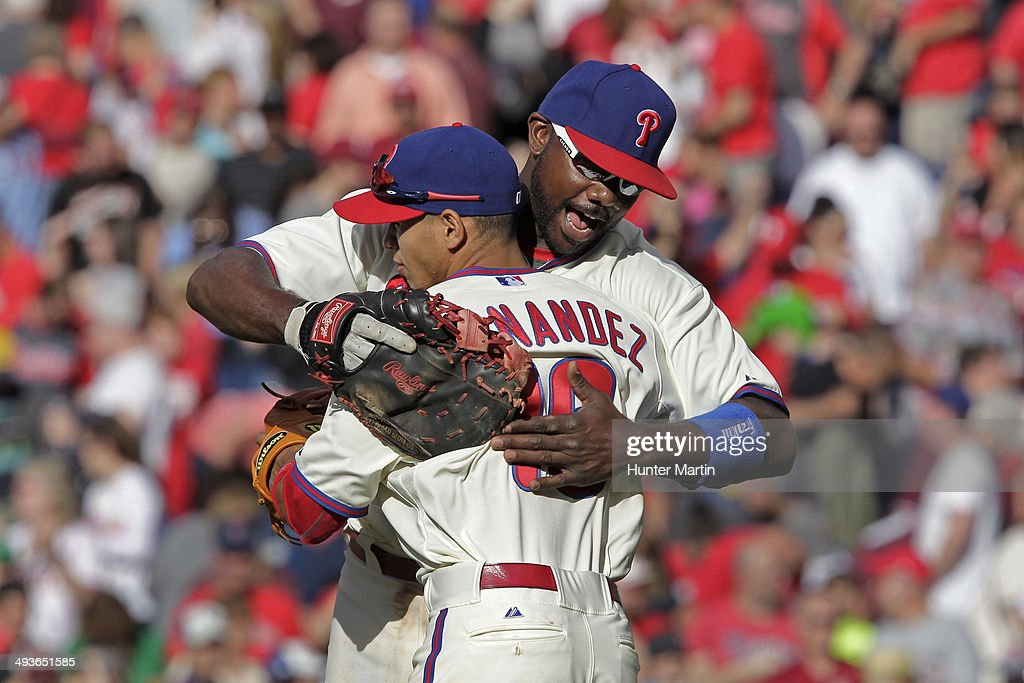 Ryan Howard #6 of the Philadelphia Phillies hugs Cesar Hernandez #16 after beating the Los Angeles Dodgers at Citizens Bank Park on May 24, 2014 in Philadelphia, Pennsylvania. The Phillies won 5-3.